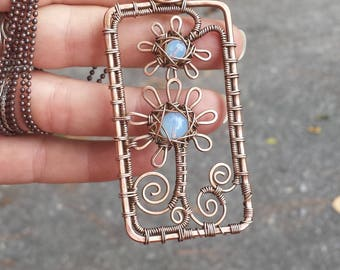Rectangular stylized blue flowers copper wire wrapped pendant necklace with glass beads