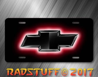 Black Red Glowing Chevy Logo on Black Background License Plate