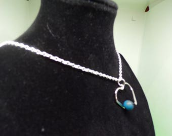 Necklace with silver and finished with a blue agate bead