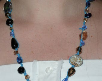 clunky blue, gold strung metal, glass, plastic beaded necklace