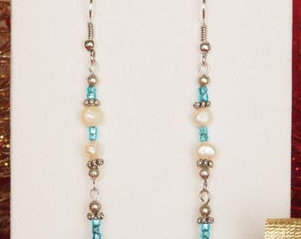 Blue earrings and long river Pearls