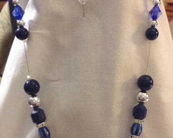 Stylish Navy Blue and Shiny Silver Teardrop Pendant with coordinating beads in this hand beaded ensemble. 3 pieces. Striking. Elegant.