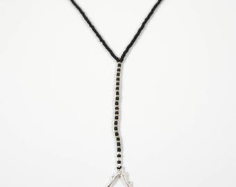 Long y necklace with matte black beads and mouse bone triangle pendant // cast bone jewelry