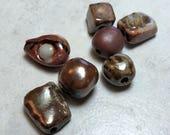 Handmade wood fired beads Handmade ceramic wood-fired beads Artisan Beads Plus