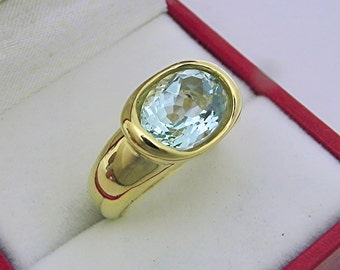 AAA  Blue green Aquamarine 2.95 carats  11x9mm in 14K Yellow gold bezel set ring.  0257