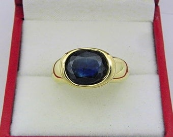 AAA  Blue Australian Sapphire 2.99 carats  10.2 x 8.2mm in 14K Yellow gold bezel set ring. 0258