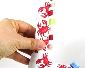 Handmade Taggy Giraffe Tactile Baby Toy - red crabs & sushi