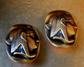 Egyptian revival vintage 60s, bronze, oval shape clip on earrings with  a raised profile of the  Fharaoh  as a centerpiece.