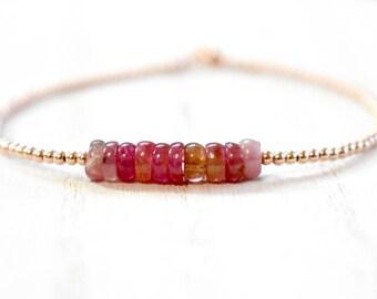 pink tourmaline slices & rose gold filled beaded bracelet. pink tourmaline and rose gold. shades of pink tourmaline string bracelet
