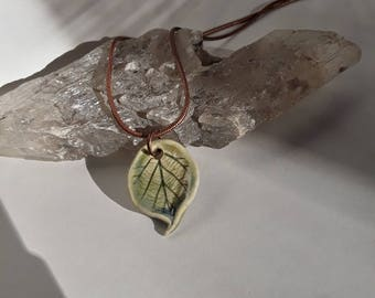Green Hazelnut Leaf Porcelain Necklace from the Garden with a Brass snake chain by Sabrina Leaf