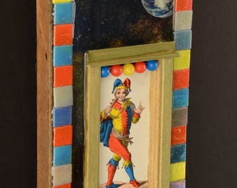 Le Mat:  mixed media collage with mosaic, assemblage art, carnival colors, tarot card by Leslee Lukosh of Foundturtle in Portland