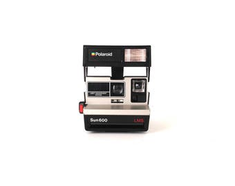 SUN 600 vintage 80s one step 600 speed FUNCTIONING working TESTED polaroid camera