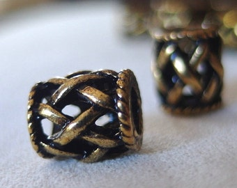 10pc Antique Gold Open Weave Metal Spacer Beads, 11mm long x 9mm wide. 5mm diameter hole, 10 pieces
