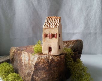 miniature stucco house in caramel colored hues red door chimney tile roof very detailed enchanted fairy garden tiny house