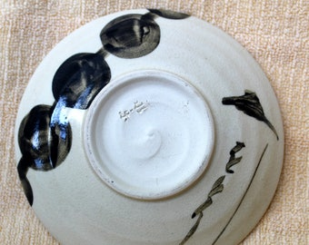 Porcelain, hand thrown plate; Asian, signed with text.