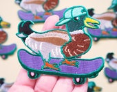 Mallard in a Cap on a Skateboard Patch - Iron on Embroidered Bird Patch - Skating Duck in a Baseball Cap Patch