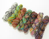 Seven - 7 sock yarn mini skeins, 25 yds each