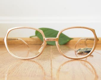 Vintage Eyeglasses 1960's Oval shaped eyeglass new old Stock Made Glasses By Rivera Brushed Gold Made In Italy