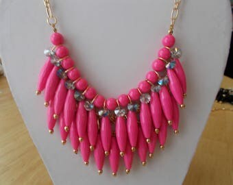3 Row Bib Necklace with Pink Pendants and Clear Crystal Dangles on a Gold Tone Chain.