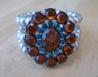 3 Row Silver Pearled Stretch Cuff Bracelet with an Orange and Blue Bead Pendant