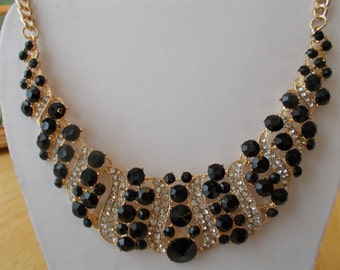 Gold Tone Bib Necklace with Black Crystal Beads and Clear Rhinestones
