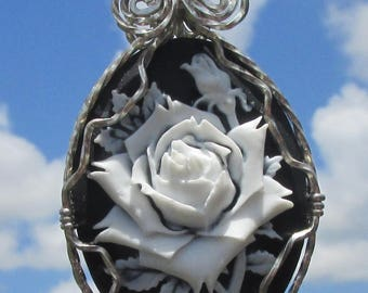 White Rose on black Cameo Pendant wire wrapped in silver.