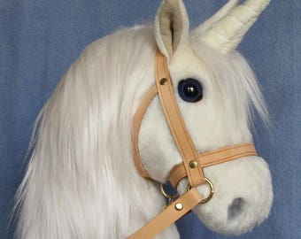 Child's Hobby horse unicorn (stick horse). Top quality plush fur fabric with hardwood pole, wheels and removable leather bridle with bell.