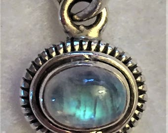 Pendant - Sterling silver with an iridescent stone