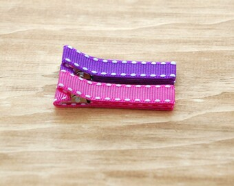 Baby , girl , toddler barrettes fully lined on double prong alligator clips in hot pink and dark purple grosgrain ribbon with white stitch