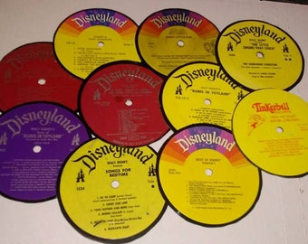 Set of Ten Disney Vinyl Record Coasters including Tinkerbell, Sleeping Beauty ,Babes In Toyland and More Free Shipping