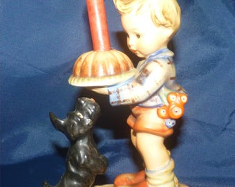 "Antique M I Hummel 1960 Figurine ""Begging His Share"" with candle Western Germany Current Value = 200 dollars. Get this at 70% off."
