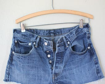 vintage 1980's distressed cut off levis 501 button fly  jean shorts 32