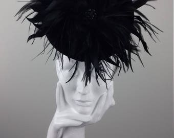Dramatic headpiece suitable for Cheltenham Races, wedding guest, Ascot, The Curragh