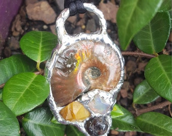 Unique, one of a kind soldered ammonite, ethiopian opal, garnet, and hand mined iron coated quartz pendant with necklace cord