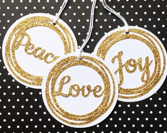 Gold Christmas Gift Tags. Peace, Love, Joy. Gold glitter with white white. Xmas gift wrapping. Wishing tree tag, gift giving. Gold gift tags