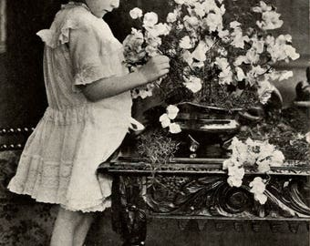 Advertising postcard Carter's Sweet Peas. Little girl with flowers Posted in 1913