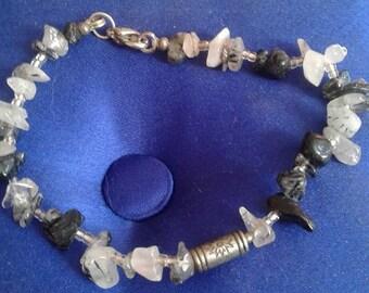 Tibetan bracelet made of rutilated quartz stone.
