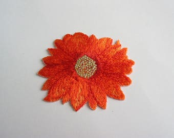 Fusible application embroidered orange flower pattern