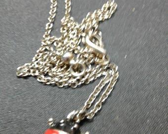 Beautiful ladybug charm on a white metal chain