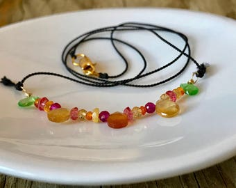 gemstone beaded necklace on sterling wire and black silk with garnets, rubies, citrine, pink topaz, orange sapphires and yellow opal