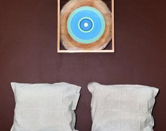 Painted wood slice in frame