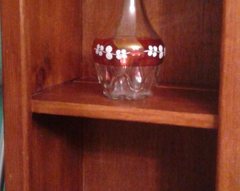 Vintage glass decanter with red and white painted design