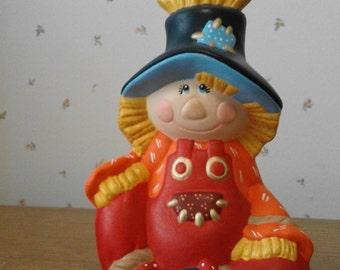 Small Ceramic Sitting Scarecrow
