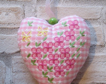 Heart made of Swiss embroidery with flowers and butterflies