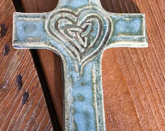 Handmade ceramic cross with hand carved design