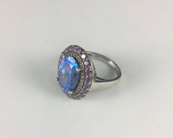 Blue Gemstone Silver Ring with Large Ice Blue Gemstone Surrounded by Small Clear and Pale Amethyst Colored Gemstones // Sz: 7.25