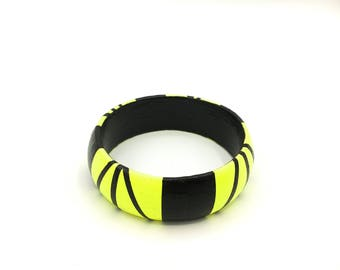 Handmade  bright geometric  wooden statement bangle in neon yellow and black