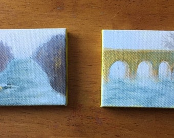 Pair of miniature paintings showing bridge over river and river in fog