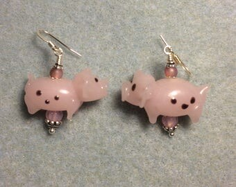 Pink spotted lampwork pig bead earrings adorned with pink Czech glass beads.
