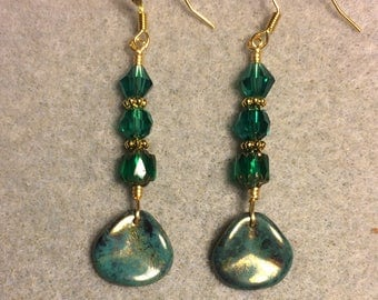 Teal rose petal dangle earrings adorned with teal Czech glass beads.